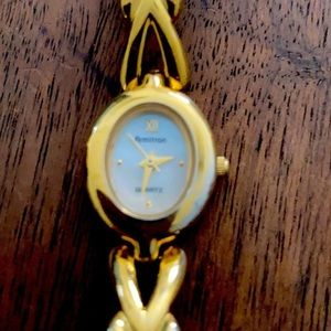 Armitron Gold watch Ladies with white face.